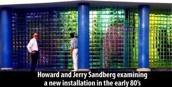 Howard & Jerry Sandbert examining a new Dichroic wall display 1980's.